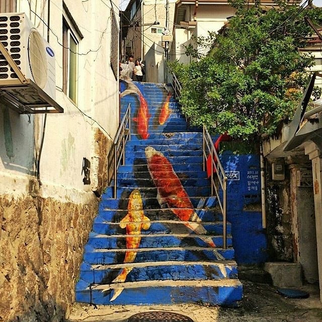 The koi-painted staircase in Seoul might just be one of the most famous staircases in the world.