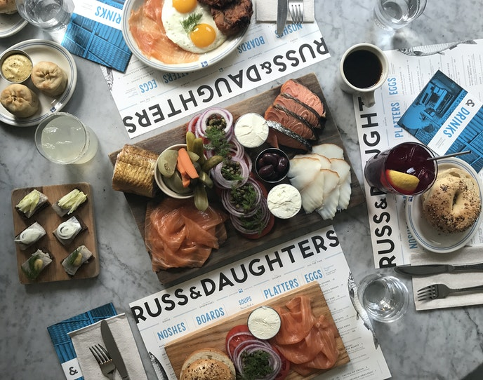 """At """"appetizing store"""" Russ & Daughters, you can pick up some of the best bagels in town schmeared or loaded high with exactly what you and the kids want."""