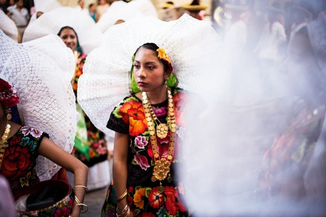 A woman dressed in the traditional clothing of the Tehuanas, Zapotecs from the narrow coastal town of Tehuantepec.