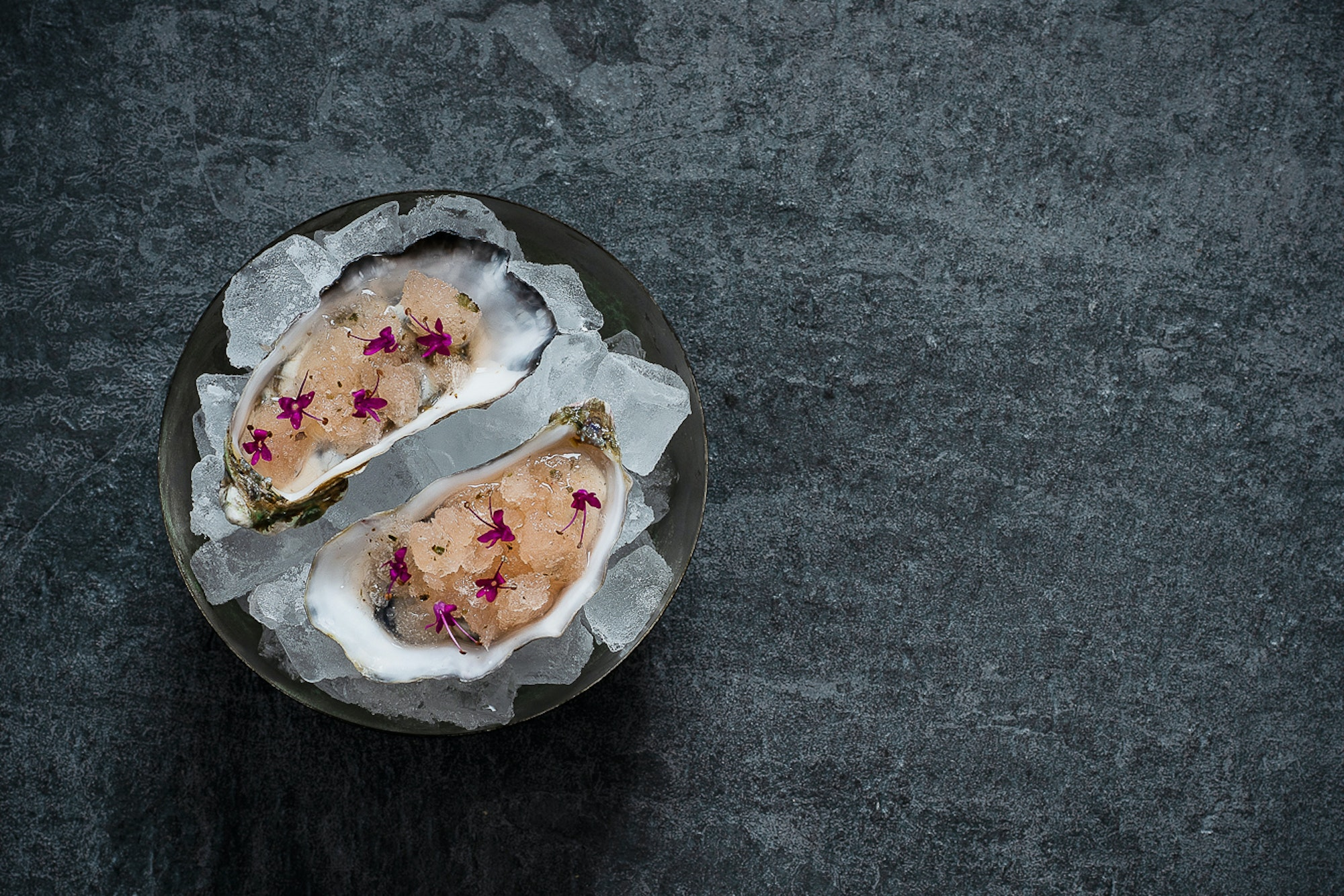 Fresh seafood, like this Kaipara Oyster, is a staple of Māori cuisine. At Hiakai, the oysters are served with a mignonette made with horopito, or pepperwood, flowers.