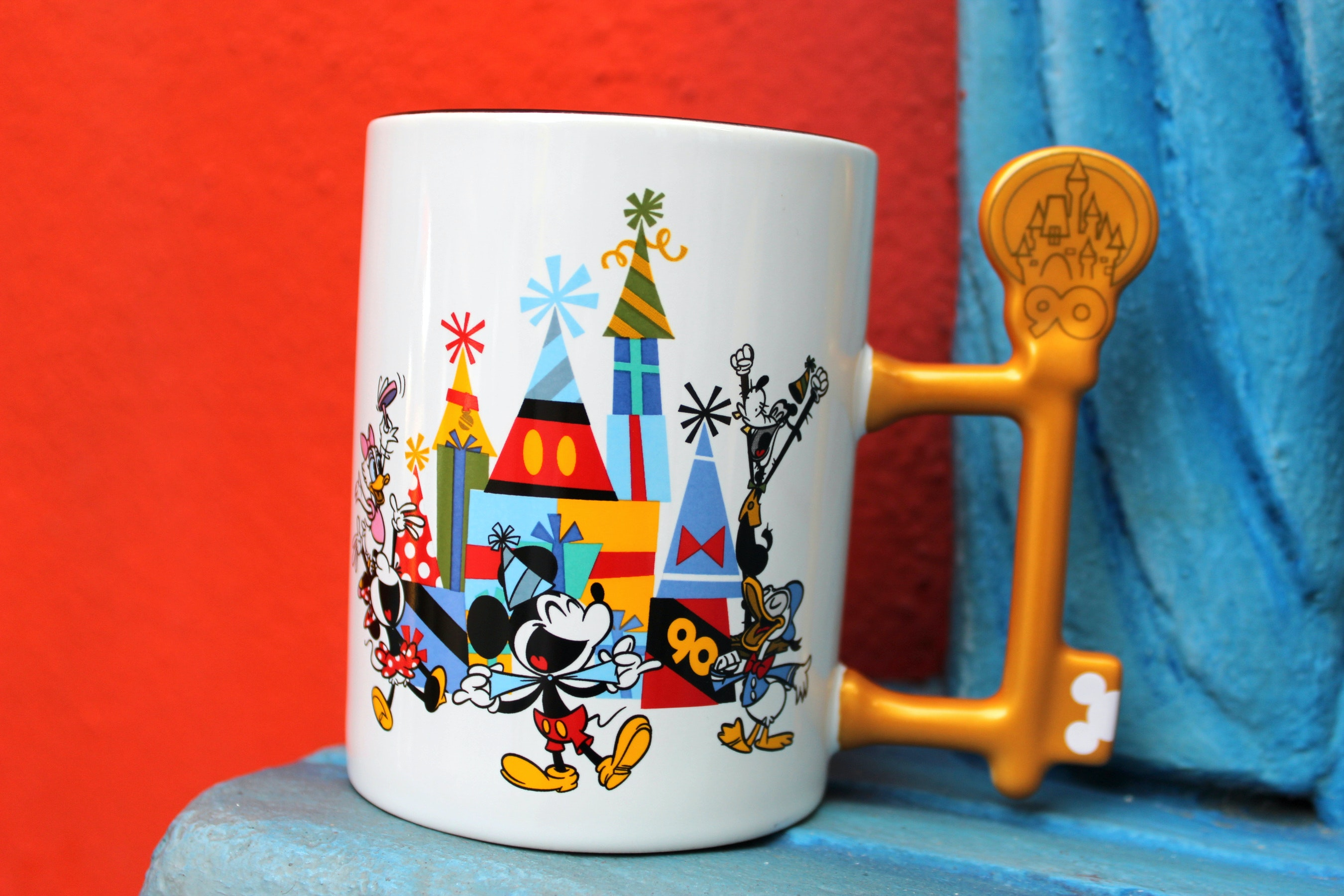 """This mug with a key-shaped handle commemorates the 90th anniversary of Mickey Mouse's introduction in """"Steamboat Willie."""""""