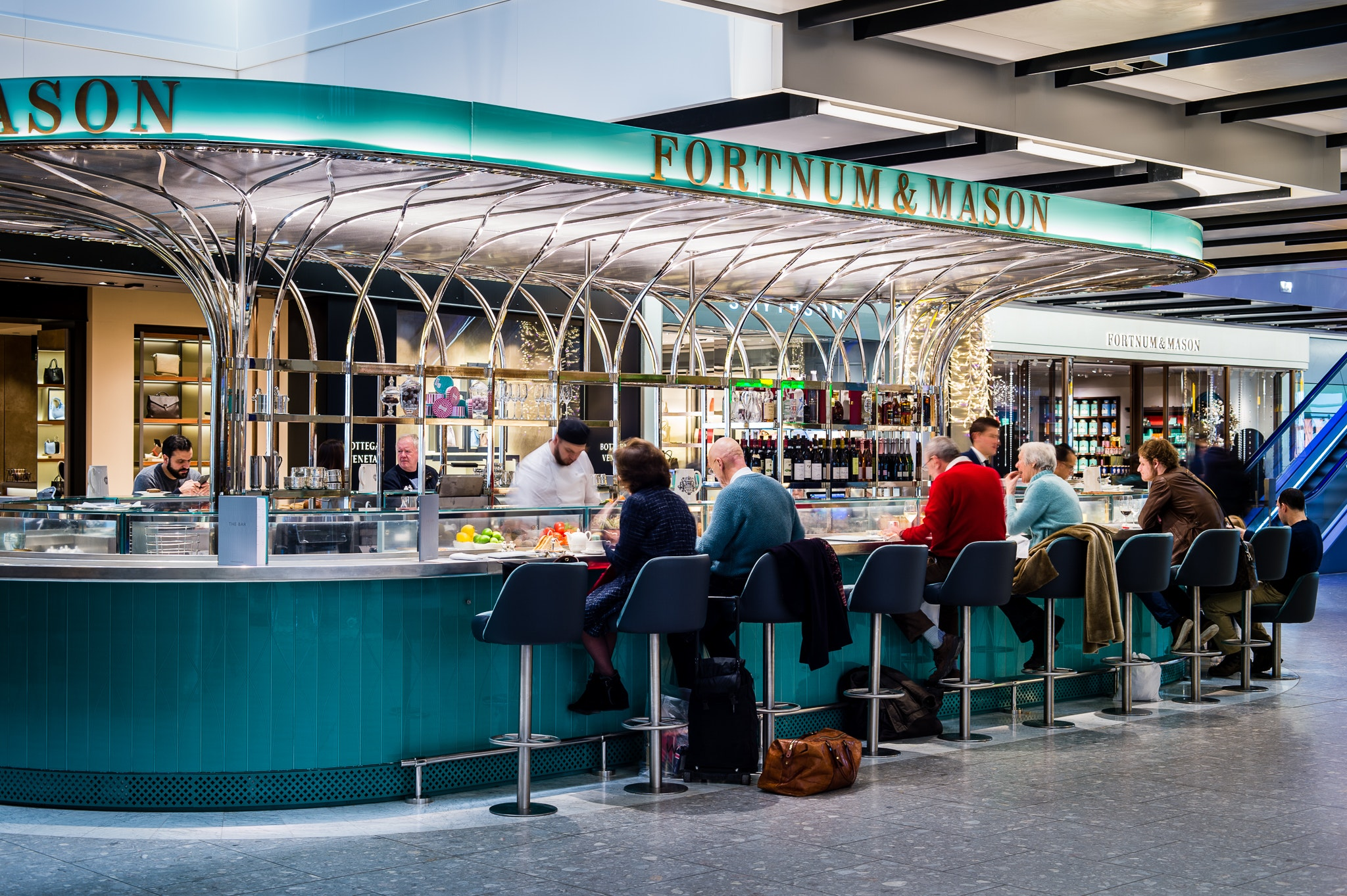 At Heathrow's Fortnum & Mason Bar, you can order champagne, wine, or a cocktail to go.
