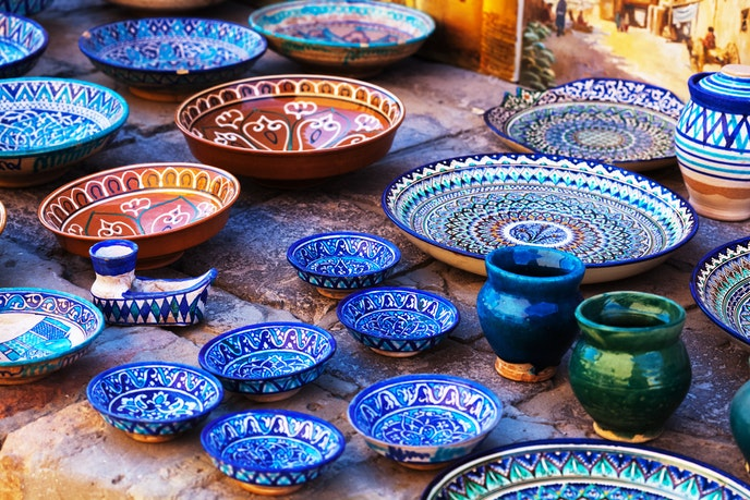 Plates and bowls on display for sale in Bukhara