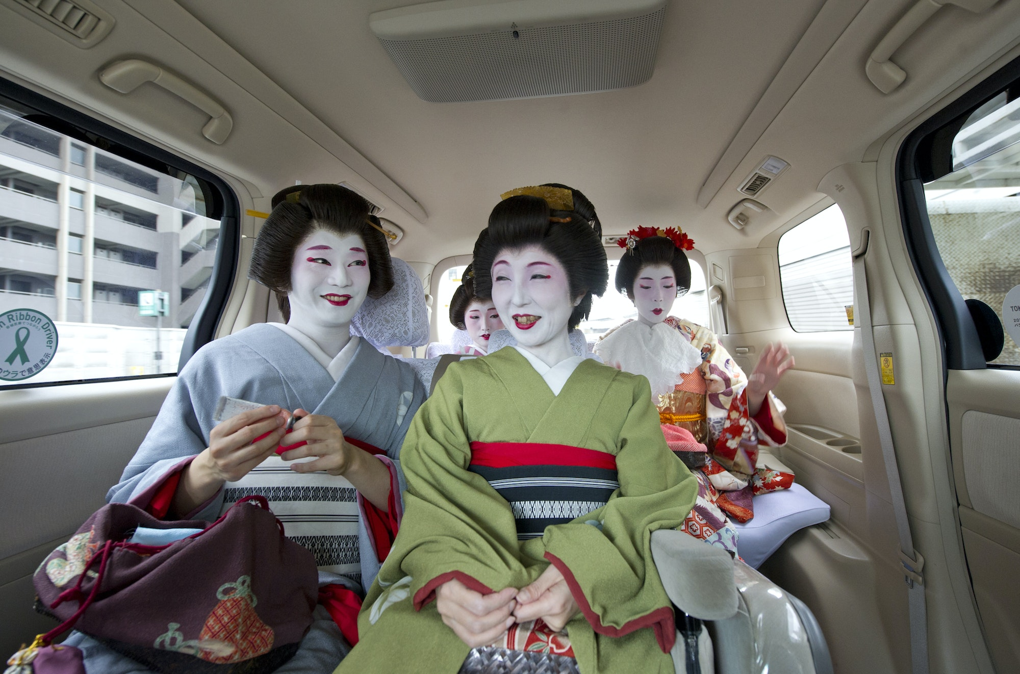 Japan's only male geisha, Eitaro (left), works to revive local geisha culture in Tokyo's Omori district.
