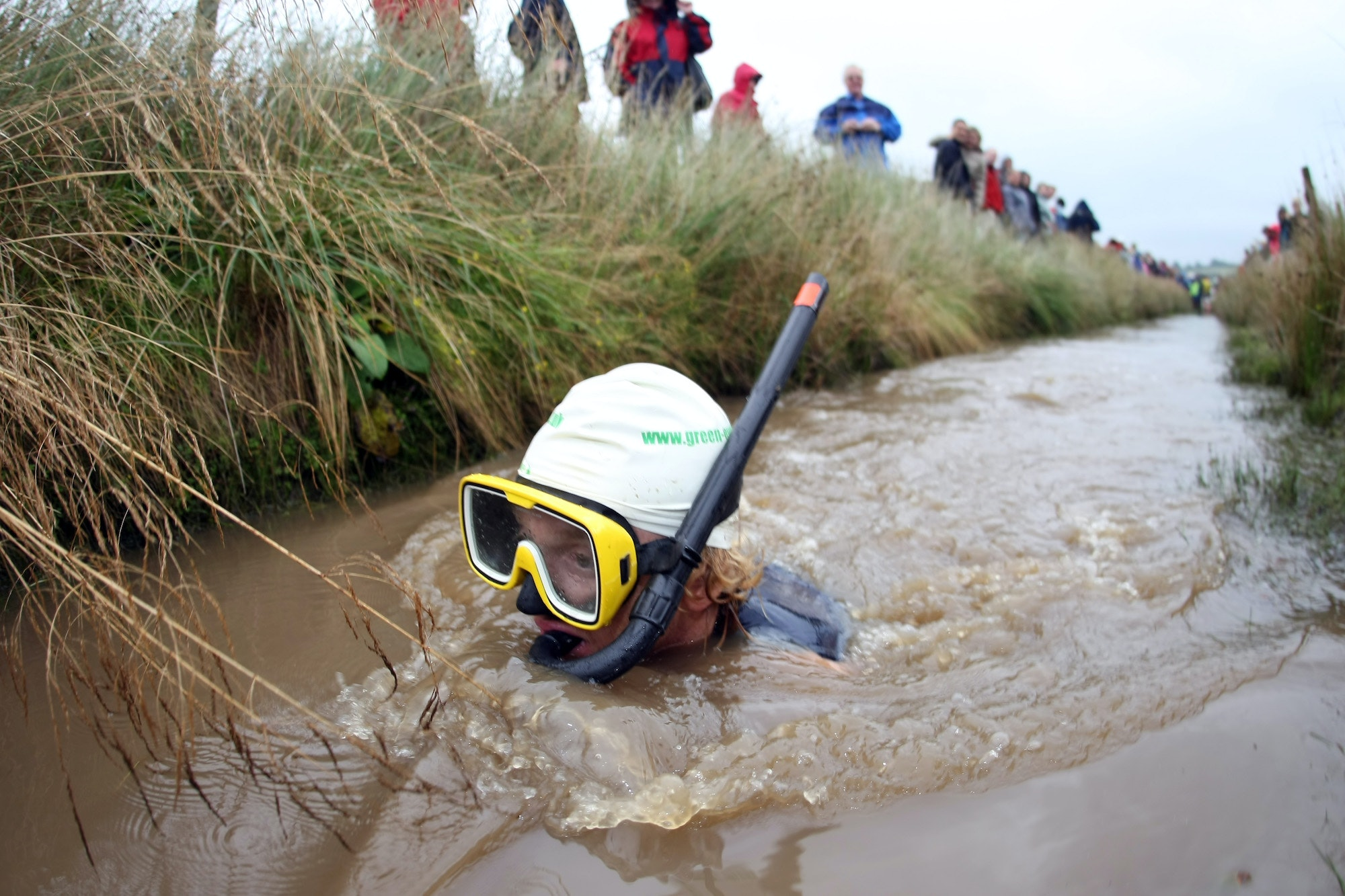 A competitor makes his way through the Waen Rhydd bog in Llanwrtyd Wells, Wales.