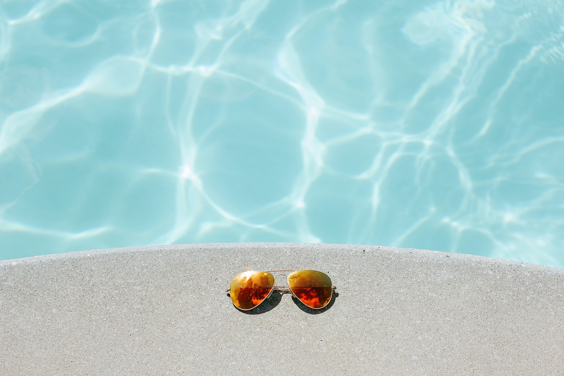 Pack a pair of polarized sunglasses to cut back on glare.