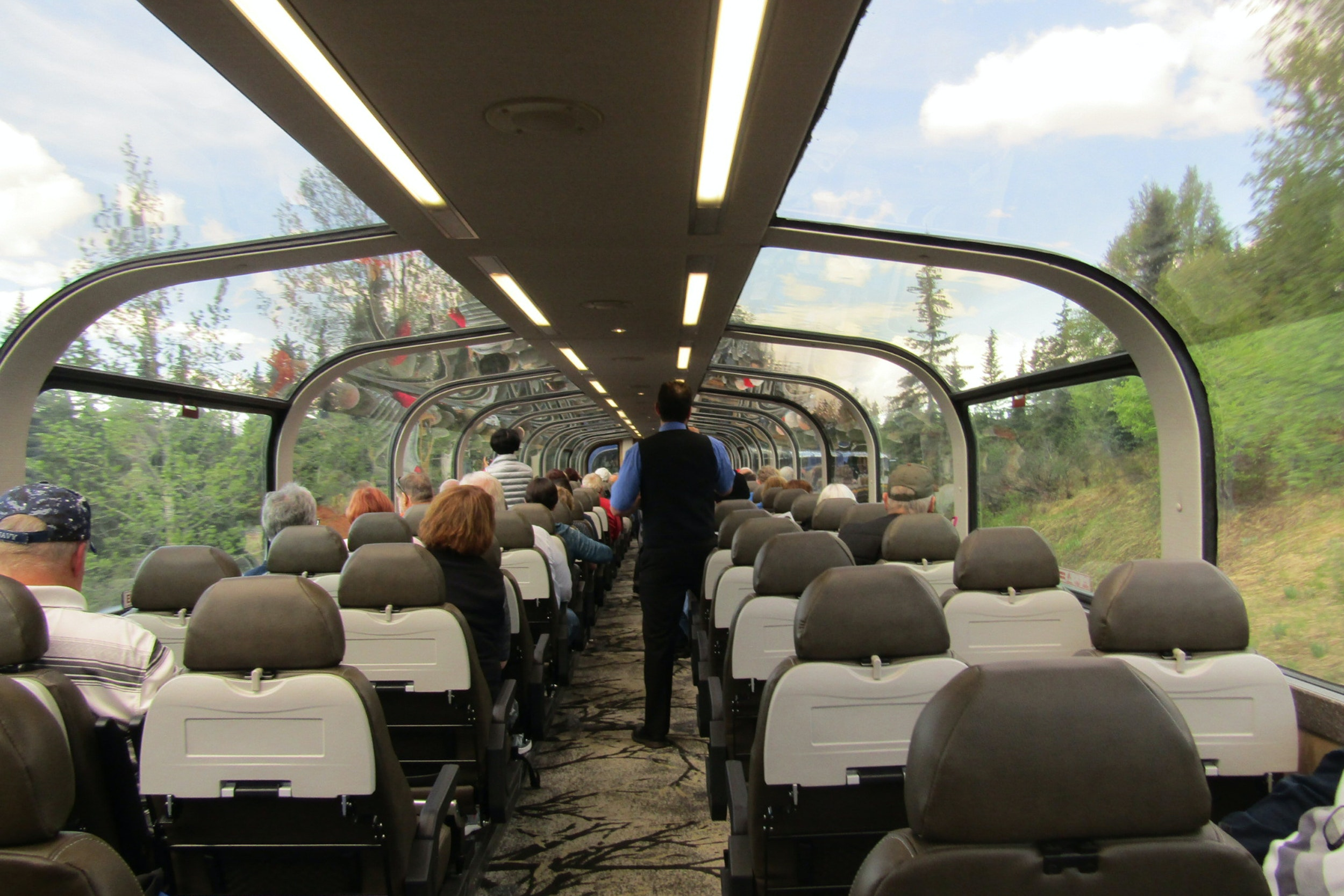 Guests take in panoramic views of the Alaskan wilderness in the glass-enclosed dome car.