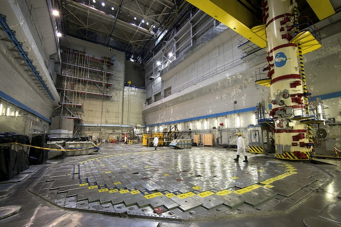 A worker walks on Reactor 1 of the Ignalina nuclear power plant.