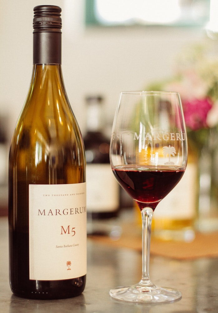 The M5 at Margerum Wines features a rich blend of grenache, syrah, and other red varietals with notes of dried cherries and balanced tannins.