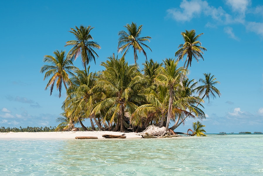 Panama's San Blas Islands are inhabited by the Kuna people whose main sources of income are tourism and coconut sales.