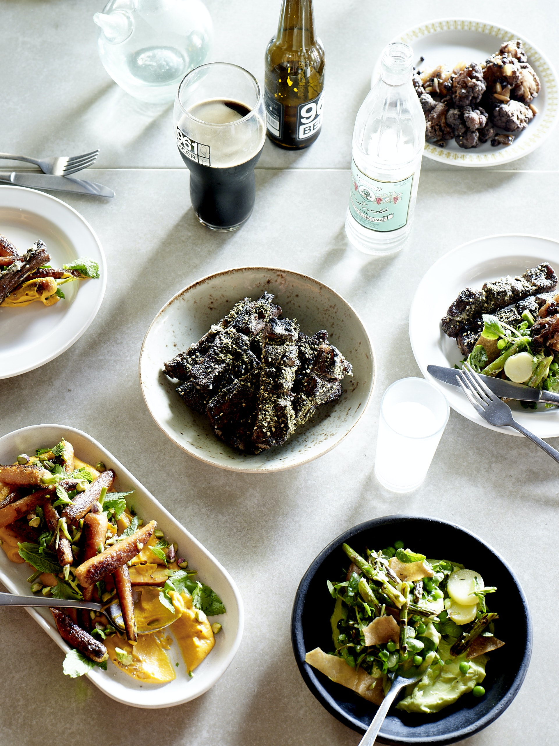 At Rumi, chef Joseph Abboud serves za'atar-spiced lamb ribs, fried cauliflower, roasted carrots, and asparagus salad.