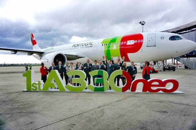 The Airbus A330neo operates the nonstop route between San Francisco International Airport and Lisbon Portela Airport. Here, representatives from TAP Portugal celebrate the first delivery of the new aircraft.