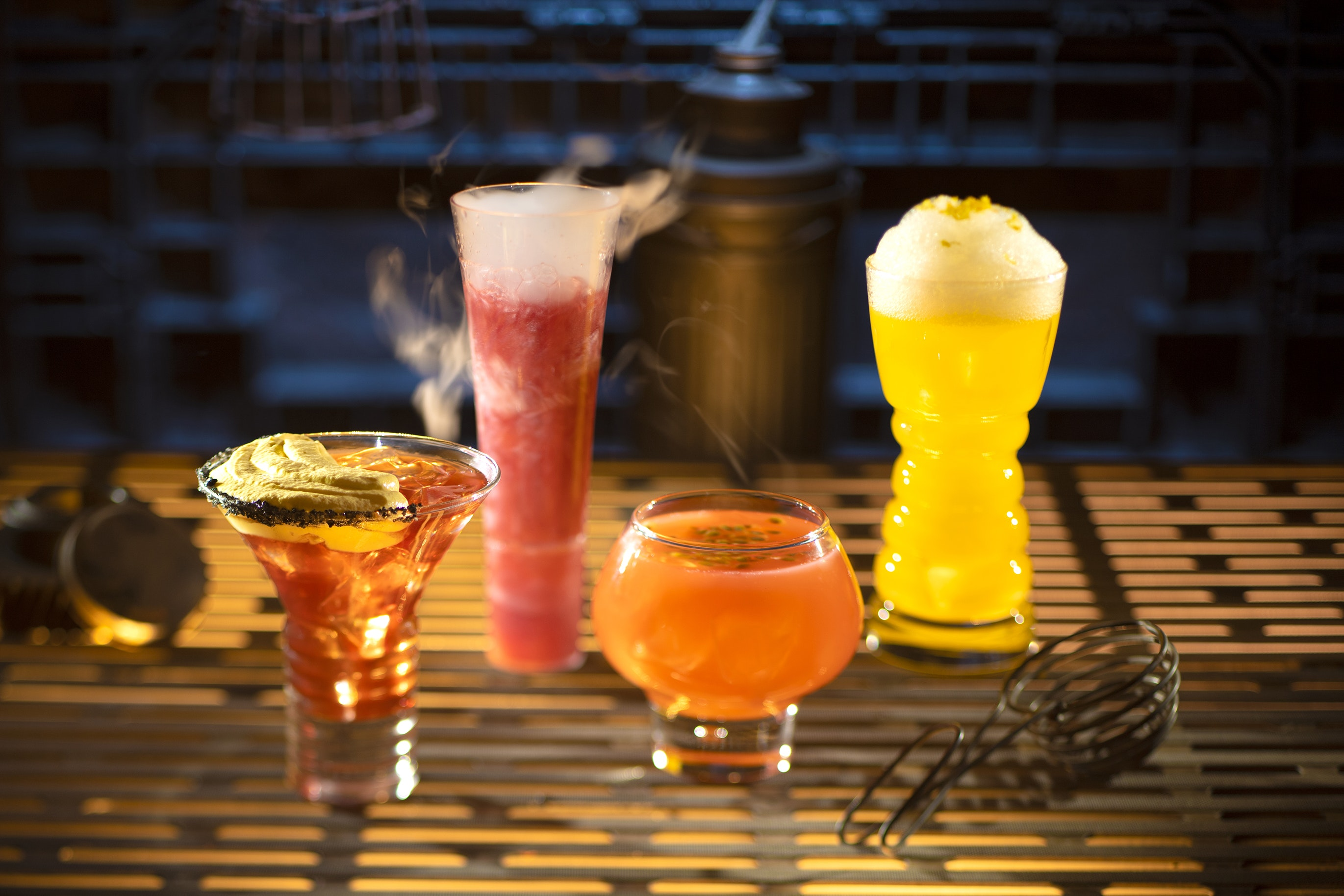 """Some of the alcoholic drinks at """"Star Wars"""" land include the Outer Rim, Bespin Fizz, Yub Nub, and Fuzzy Tauntaun (from left to right)."""