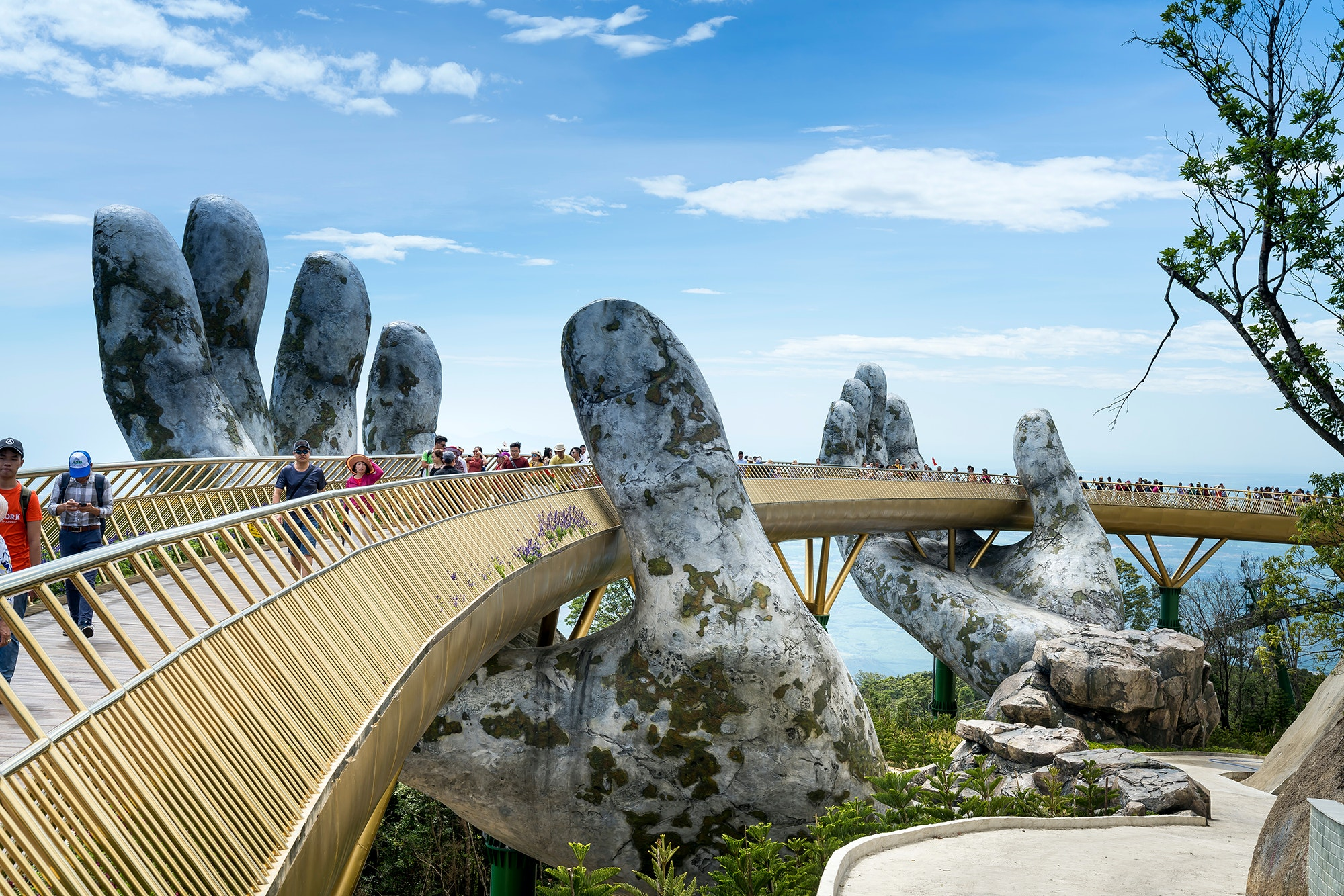 Vietnam's new Golden Bridge has been drawing tourists to the Ba Na Hills outside of Danang.