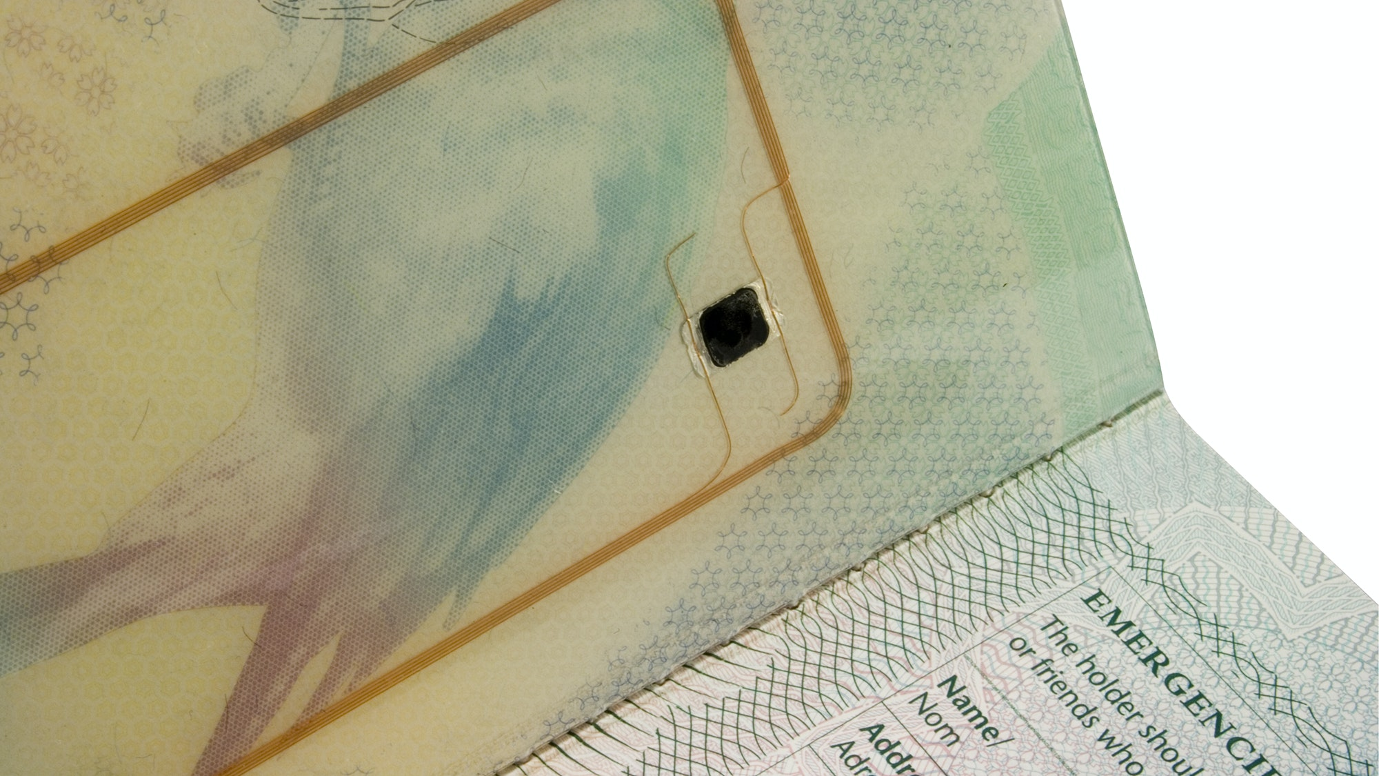 RFID chips, like this one embedded in the cover of a British passport, are similar to the I.D. chips implanted in pets.