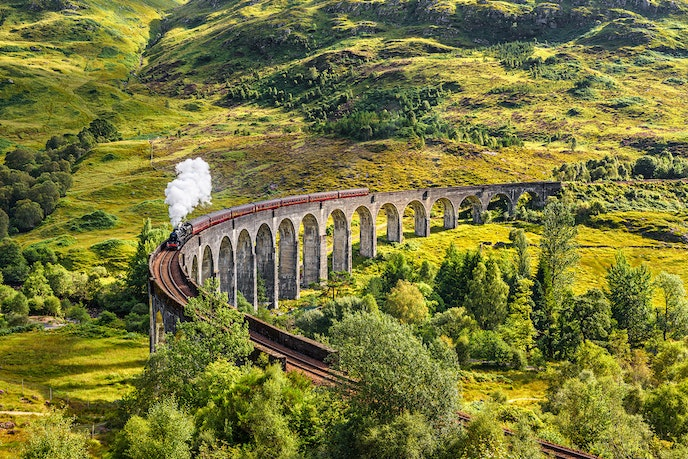 The Jacobite train passes over the Glenfinnan Viaduct.