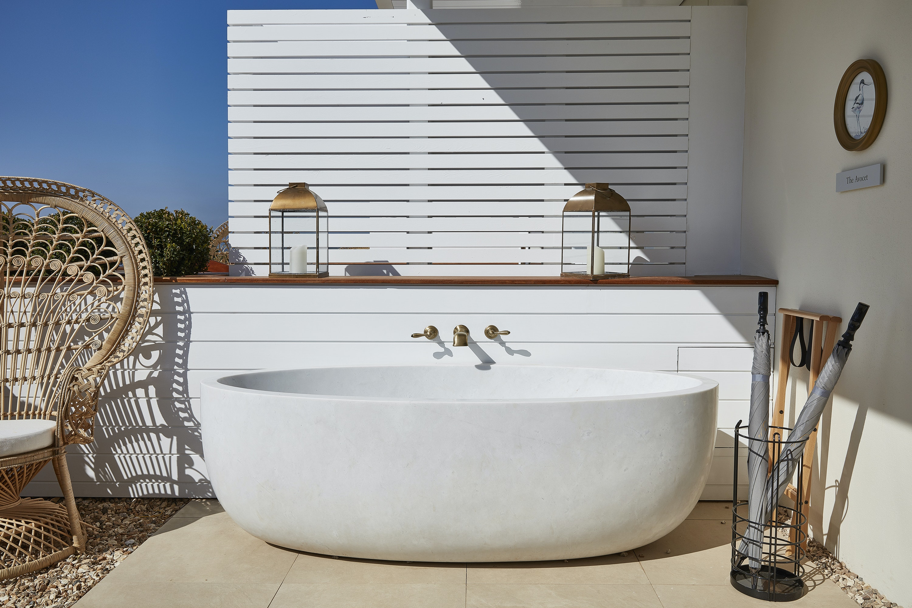 Savor the sunset from the outdoor tub in Lympstone Manor's Tern Suite.