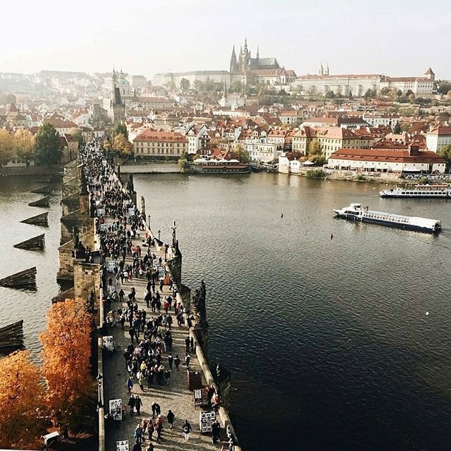 @conor.a found the perfect people-watching view of Prague on an autumn afternoon.