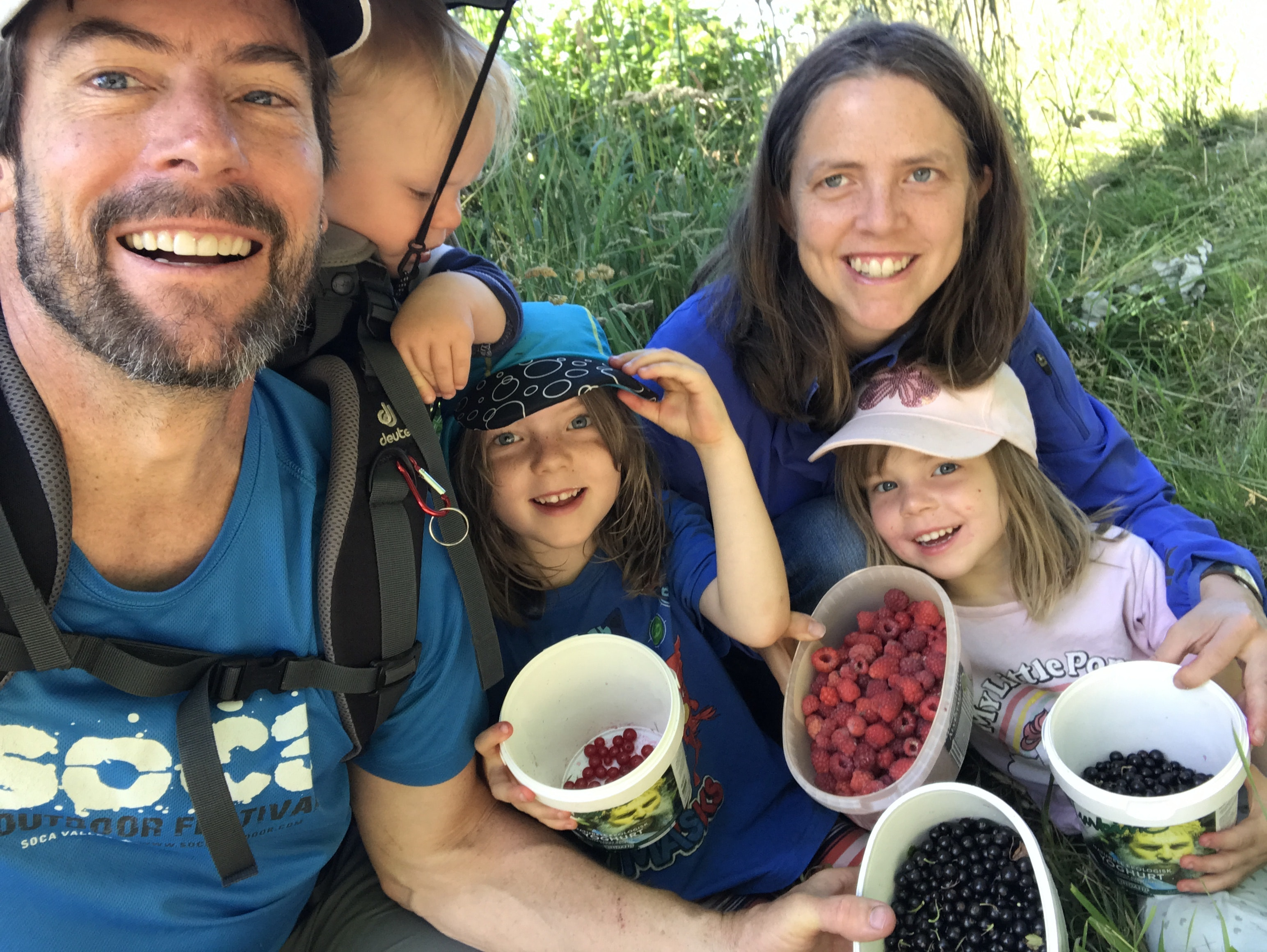 Chris (from left), Elliot, Moa, Emma, and Lyra with their morning haul of black currants, raspberries, and red currants from the fields below their home.