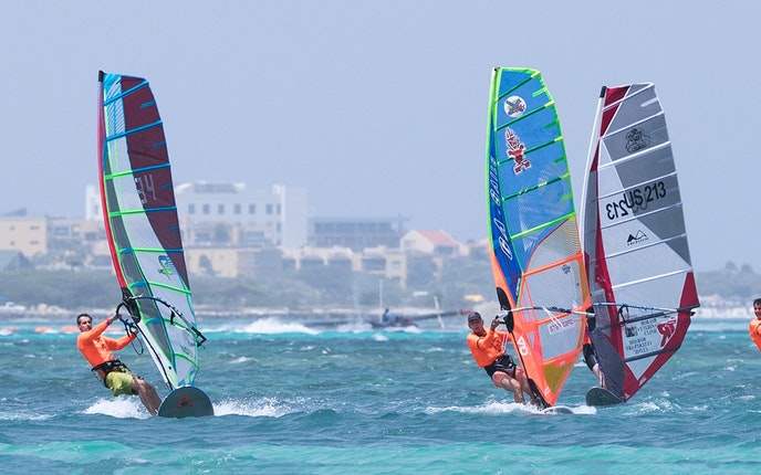 Kids and amateur athletes perform some serious stunts at Aruba's annual windsurfing competition.