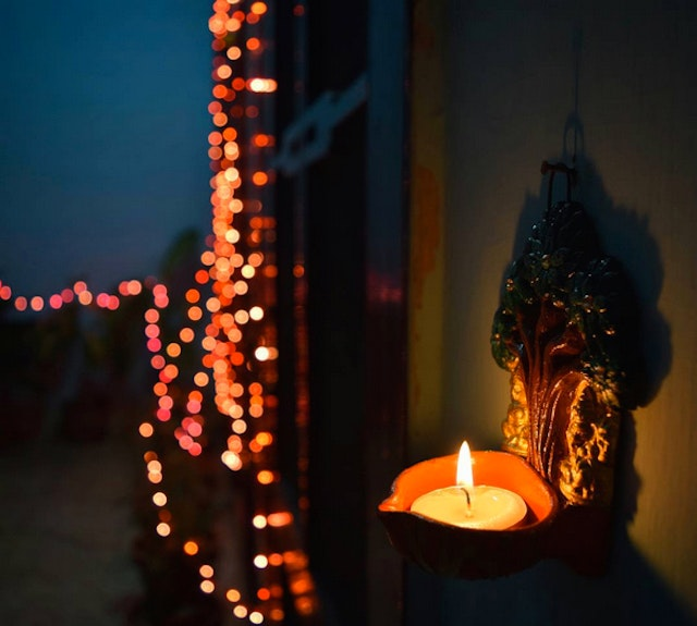 String lights and candles decorate houses.