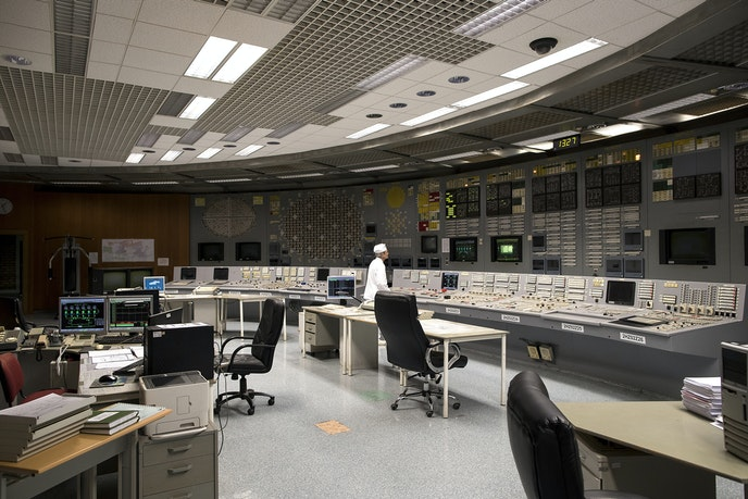 A specialist works at the control panel of the Ignalina nuclear power plant.