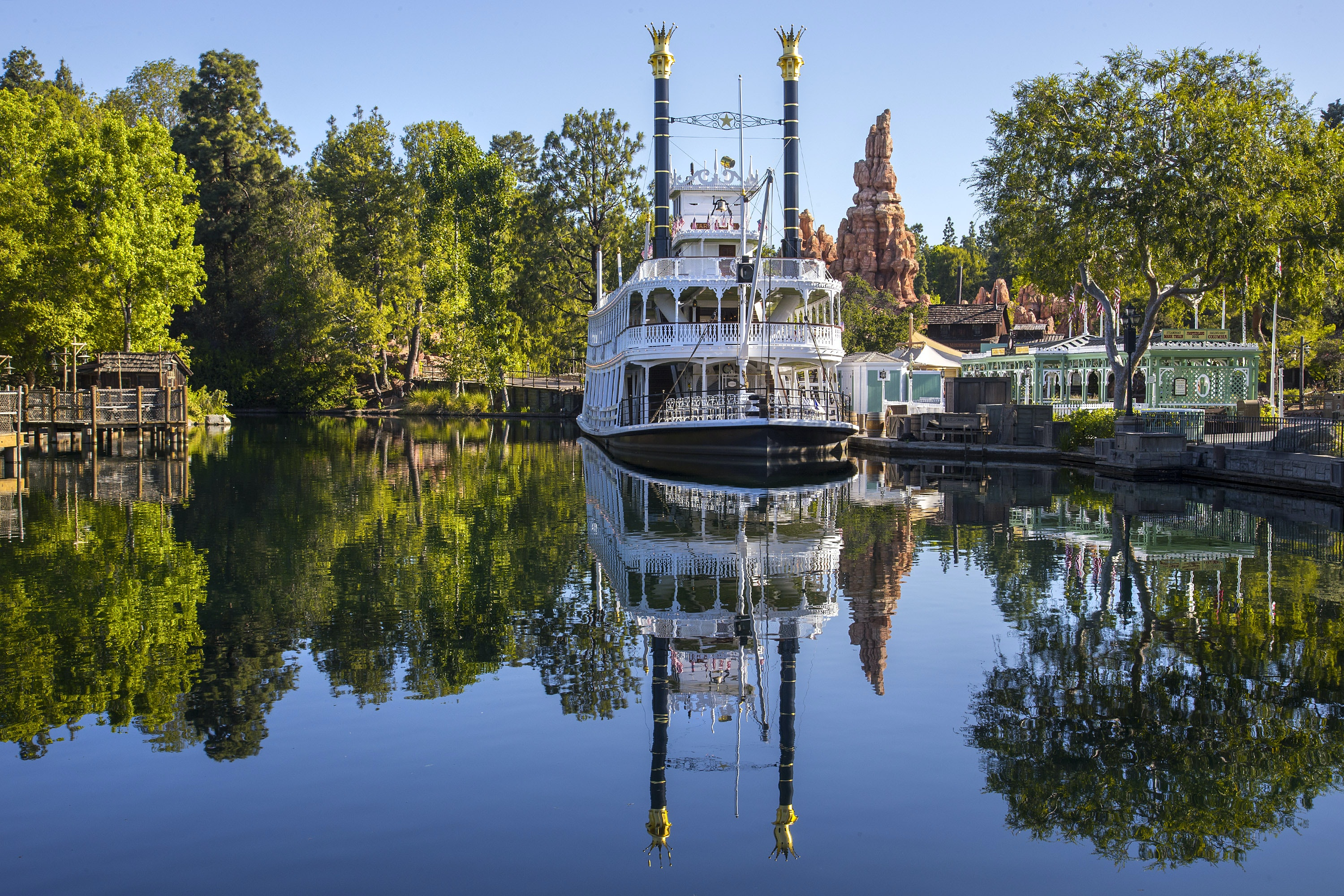 The Mark Twain Riverboat departs from a dock outside Big Thunder Mountain.