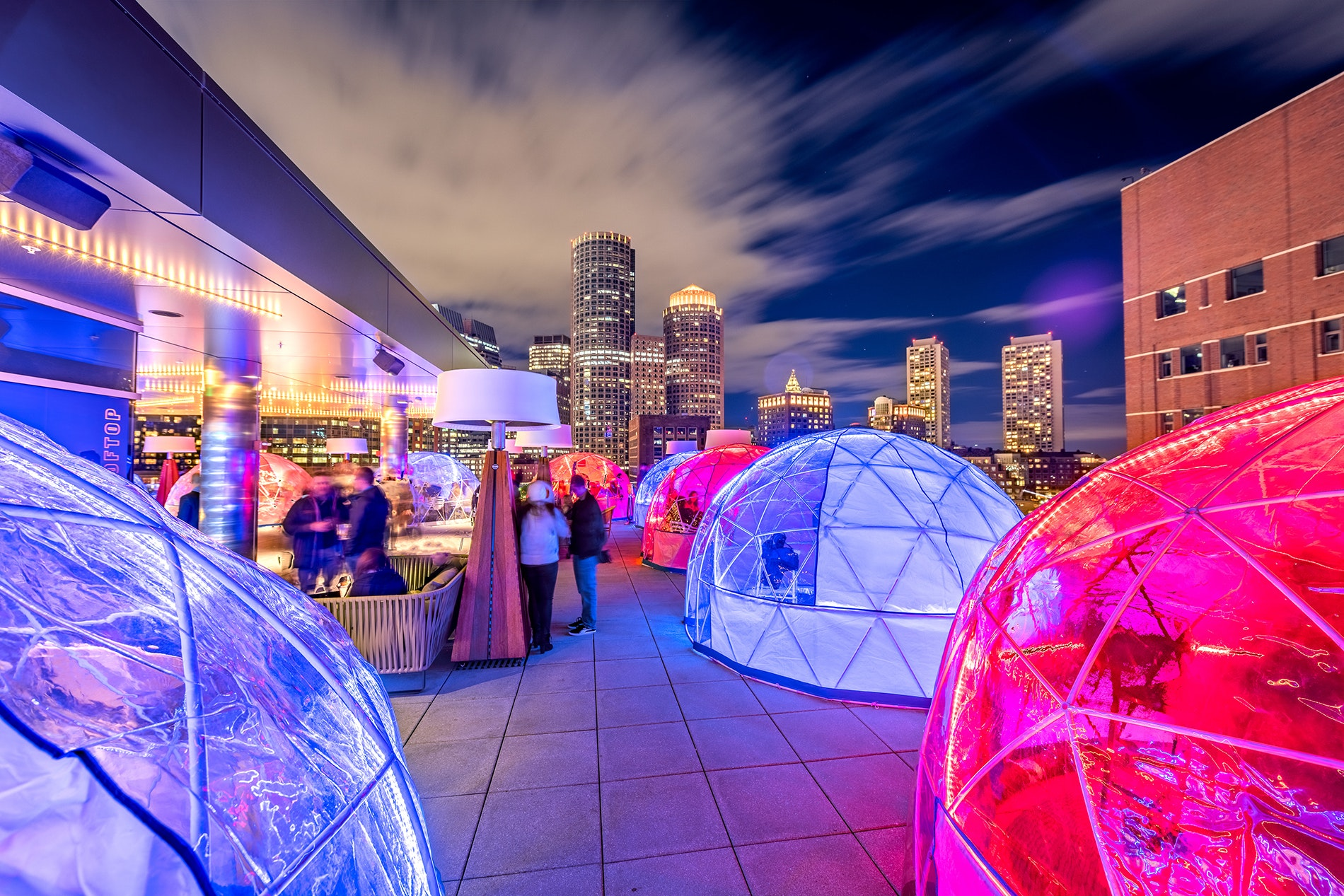Hunker down for Boston's winter chills in a heated and illuminated igloo atop The Envoy Hotel.