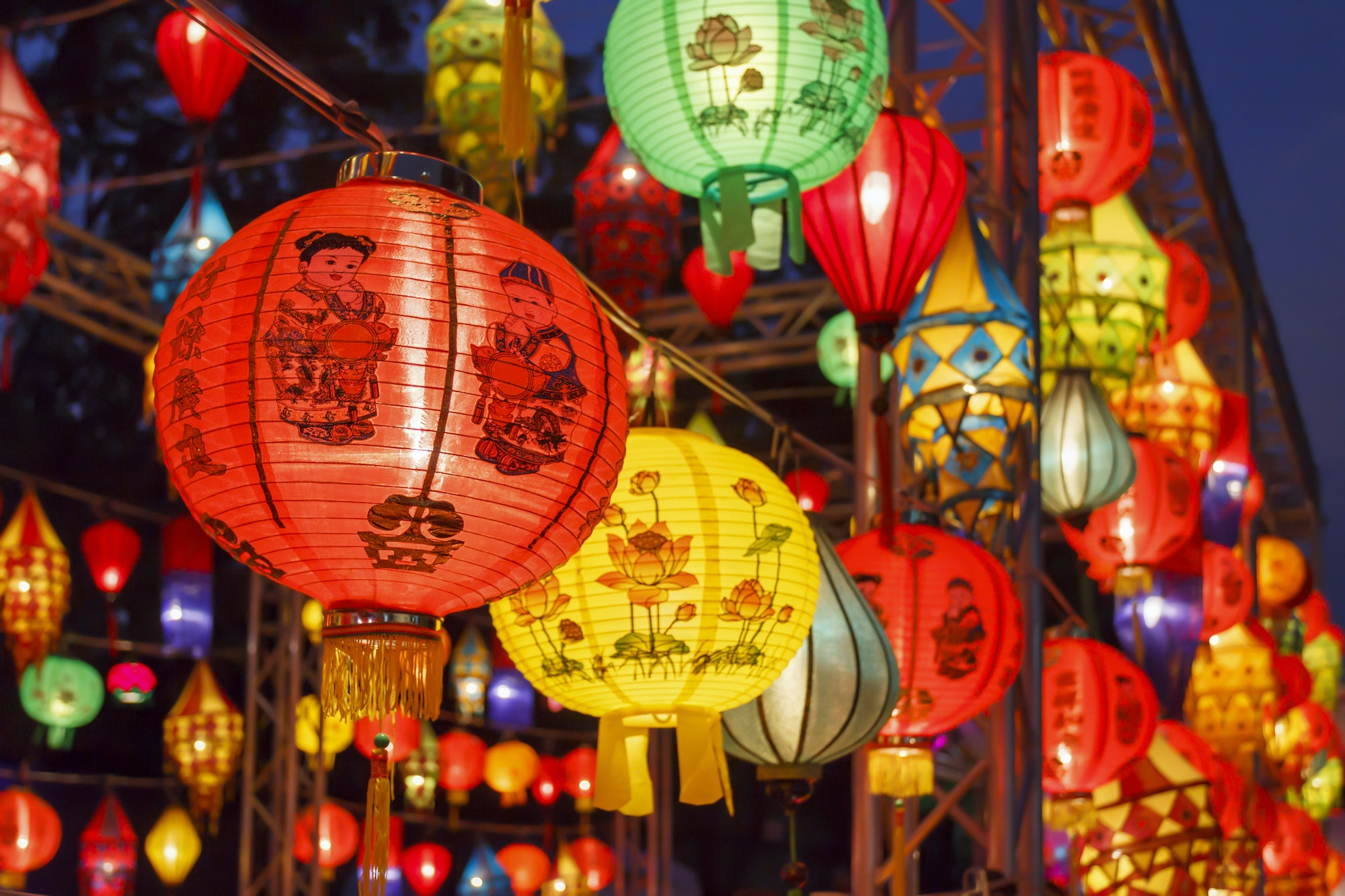 Chinese lanterns are traditionally red, as the color is believed to symbolize warmth, happiness, and good fortune.