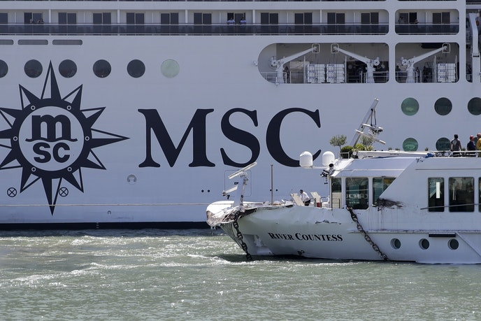 "The MSC ""Magnifica"" cruise ship passed by the tourist boat in the foreground that was struck by the MSC ""Opera"" ship on Sunday."