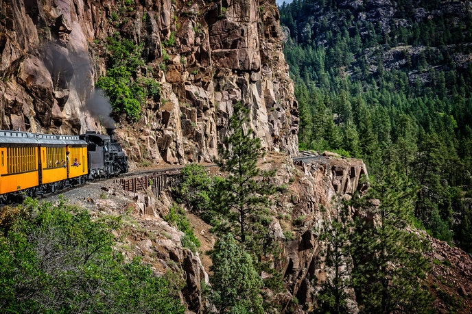 Take in the beauty of the San Juan Mountains on the Durango and Silverton Narrow Gauge Railroad.