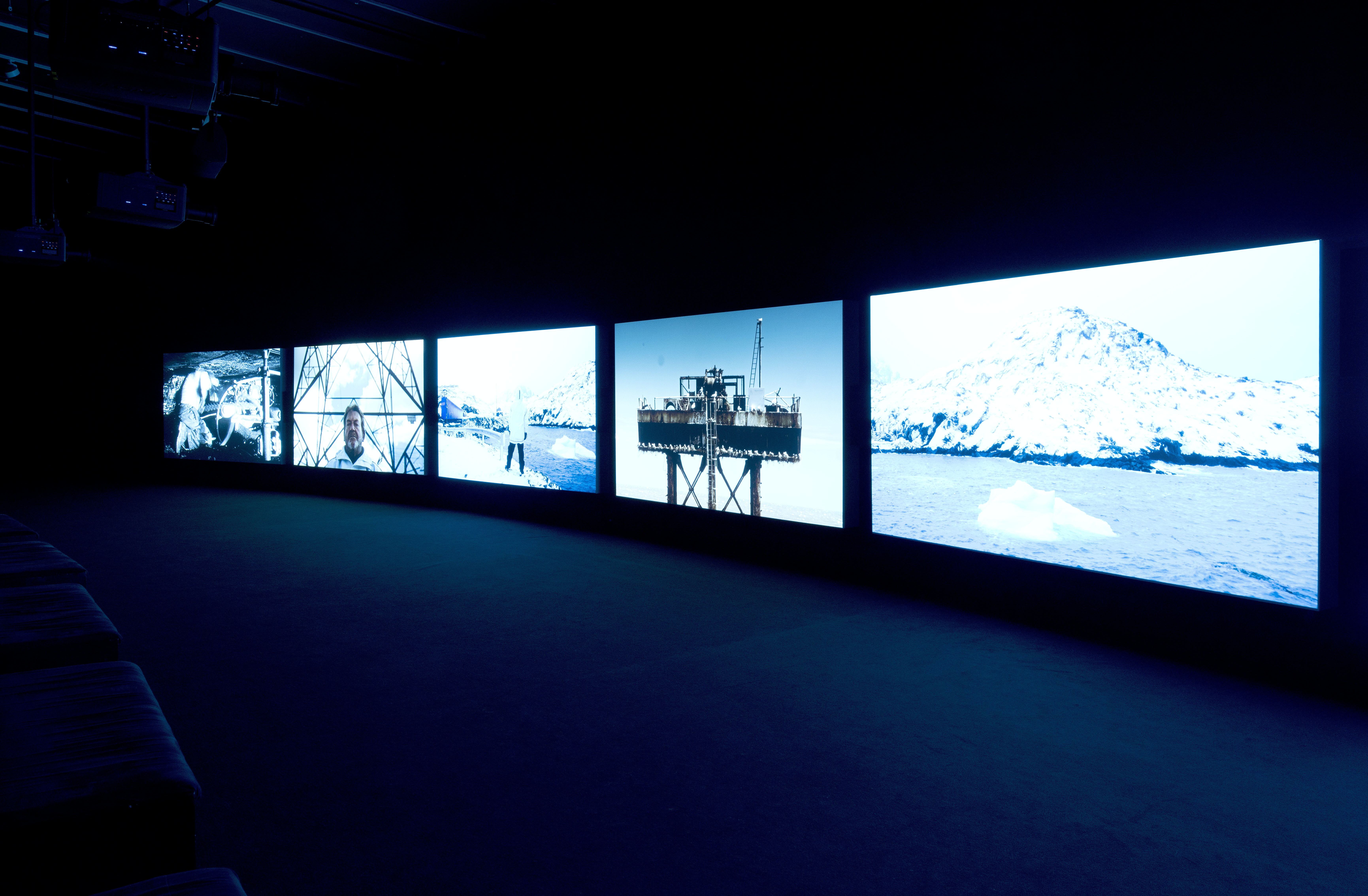 """The installation view of John Akomfrah's """"Purple,"""" displayed at The Curve, Barbican Centre in 2017."""