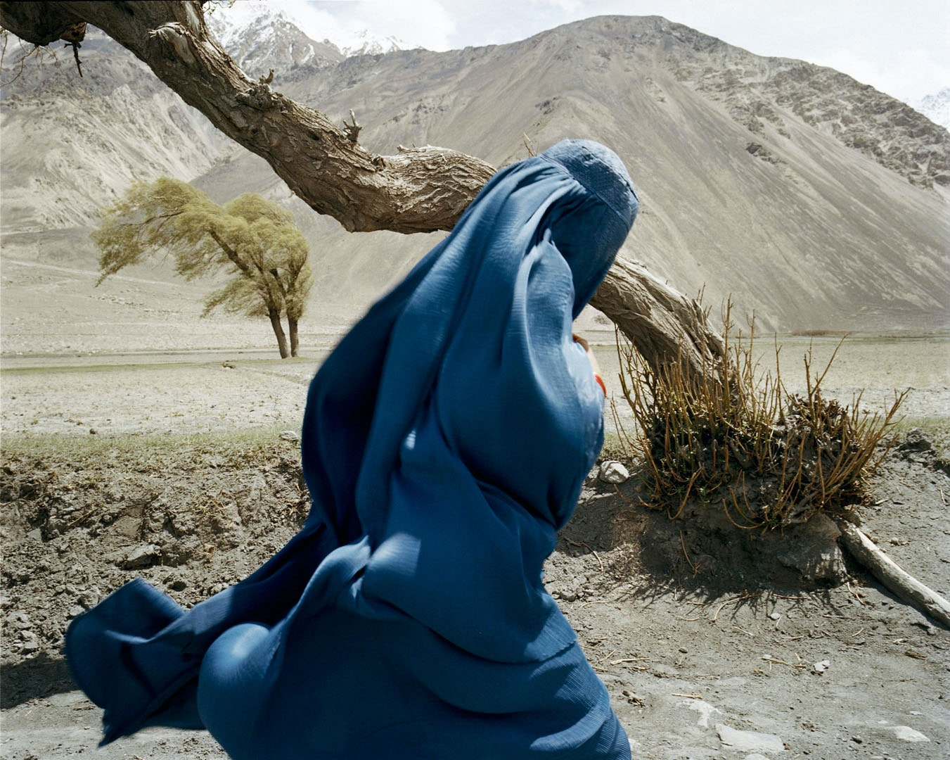 A veiled Sunni woman made her way back to mainland Afghanistan from the desert of the Wakhan Corridor.