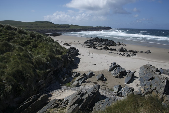 Machir Bay, on the Scottish island of Islay, may not be sun soaked, but its dramatic skies and excellent birdwatching afford a different kind of beauty.