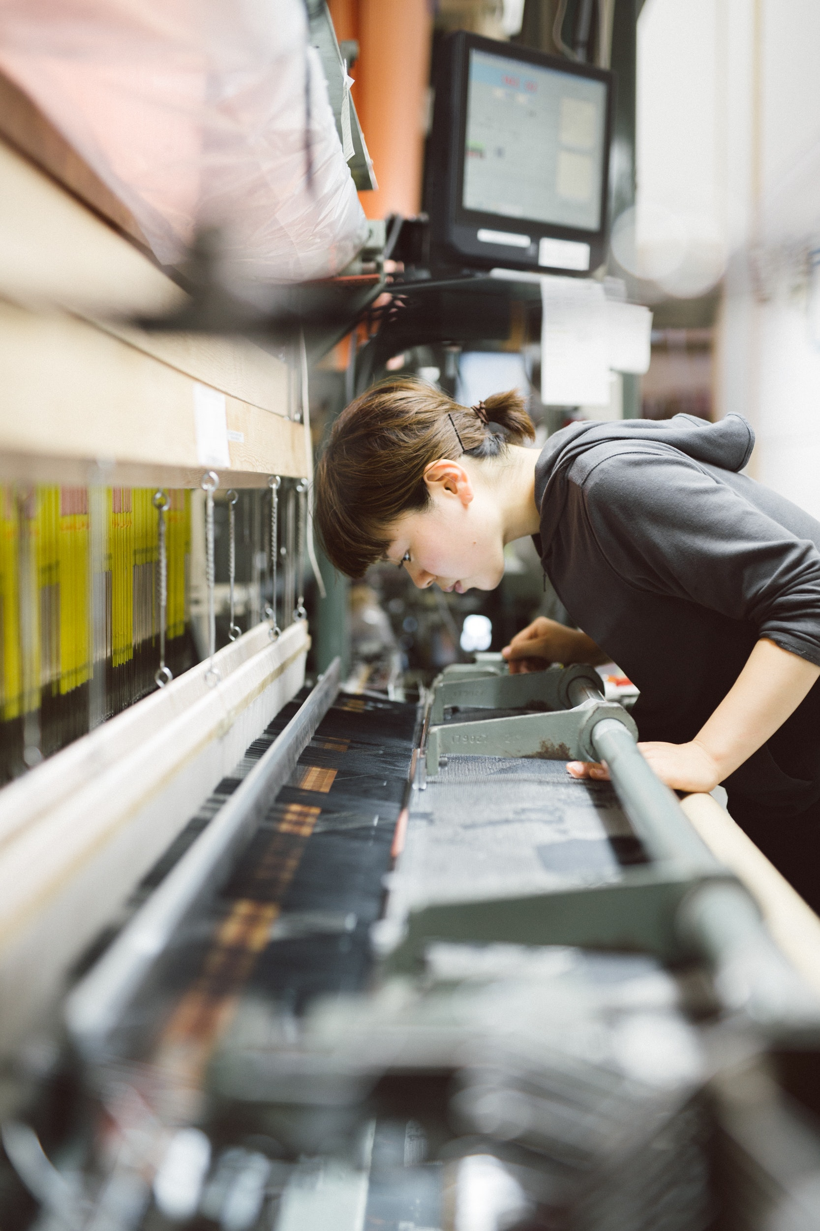An apprentice at Hosoo creates decorative silk fabric using a three-dimensional weaving method that dates back to the company's founding in 1688.