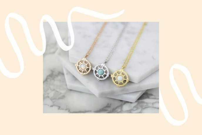 These rose-gold compass necklaces arrive in a gift box.
