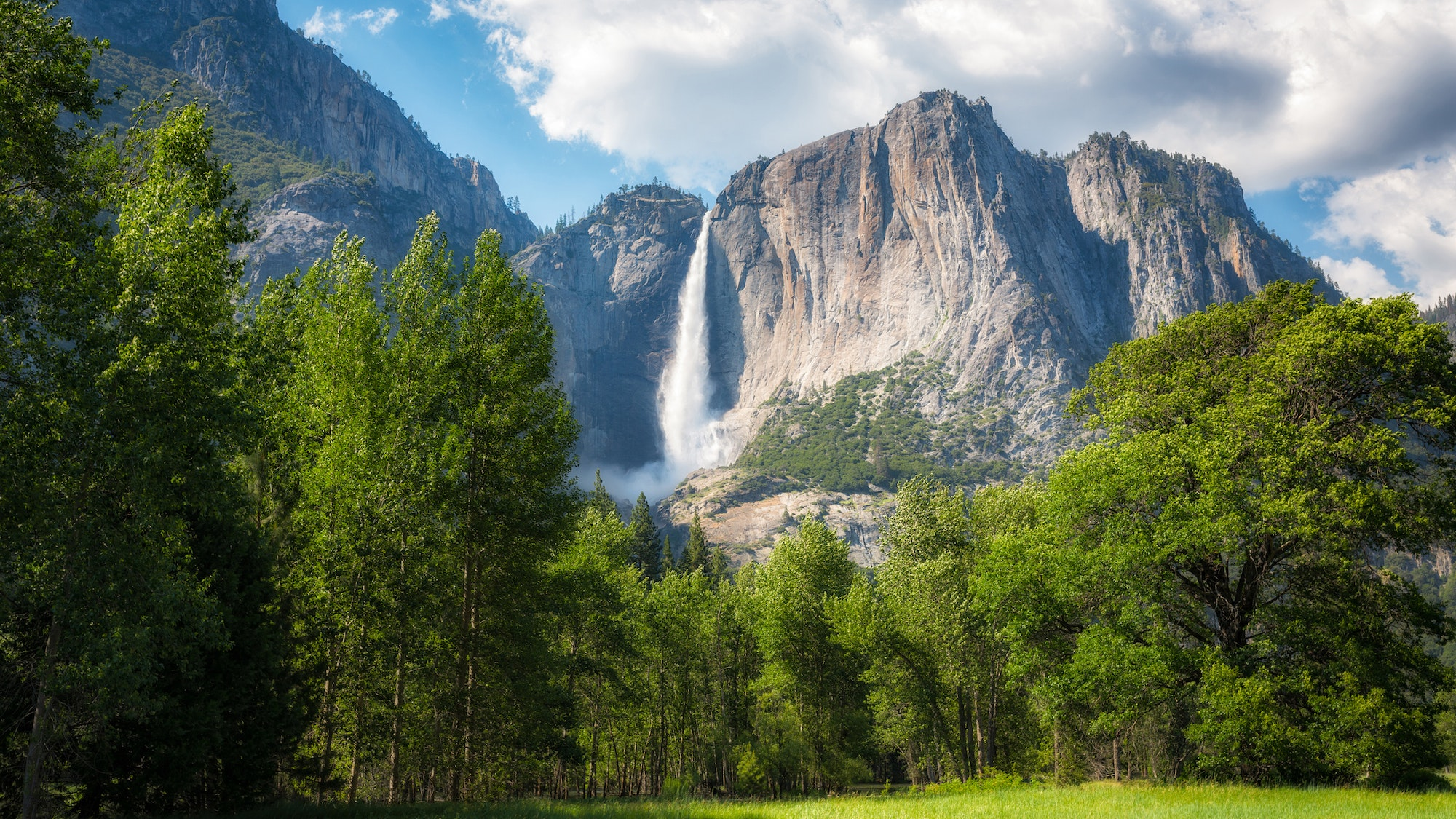 Yosemite National Park is famous for its towering waterfalls, granite cliffs, ancient sequoias, and valley meadows.