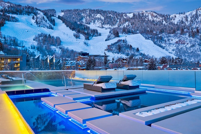 11 toasty outdoor pools in snowy places afar for Pool design usa