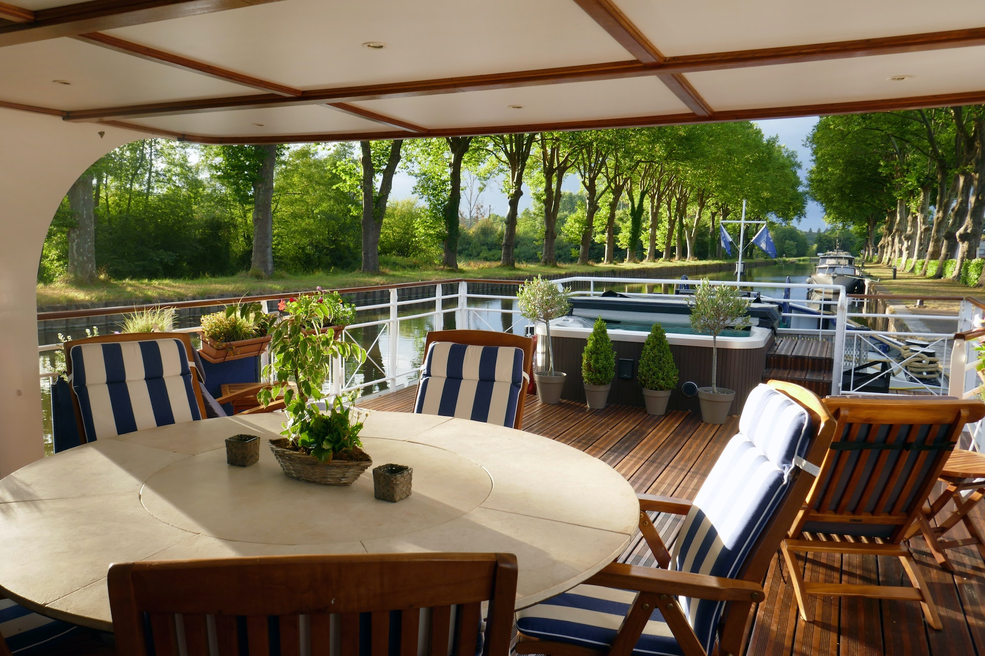 Most barge cruises, like this one on the Canal du Midi in France, take place aboard converted historic vessels, but the boats still have many of the same amenities as a boutique hotel.