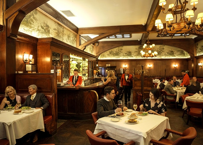 """Musso & Frank Grill appears in a """"Once Upon a Time"""" scene featuring Leonardo DiCaprio, Brad Pitt, and Al Pacino."""