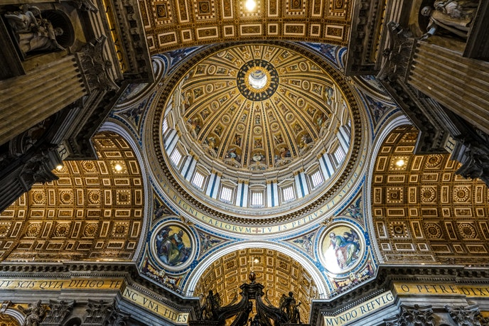 Mosaics of saints, the Virgin Mary, and Christ the Redeemer adorn the interior dome of St. Peter's Basilica