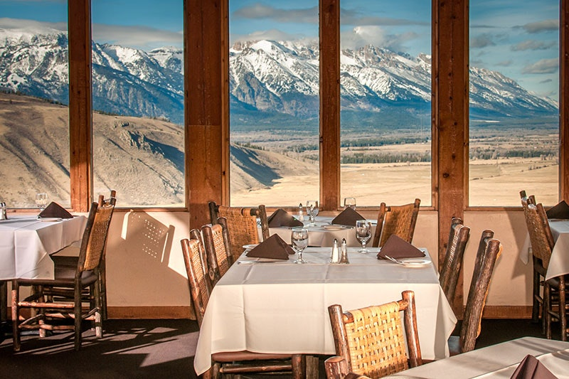 The Tetons serve as the backdrop at Spring Creek Ranch's property restaurant, The Granary.