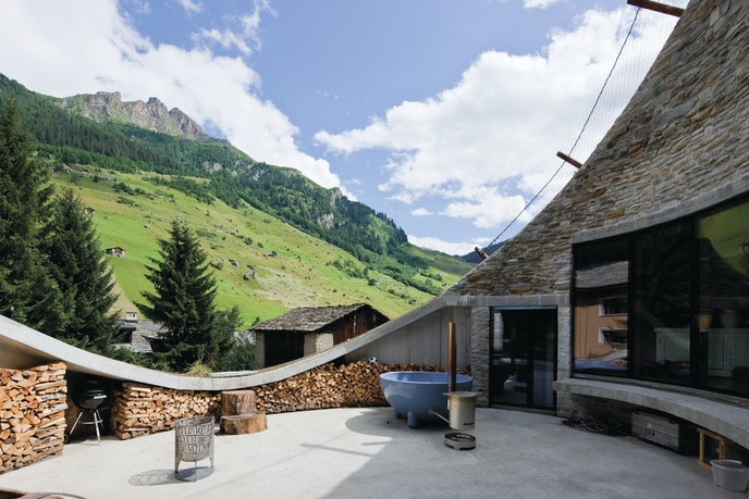 """""""Villa Vals"""" is carved into a mountainside in the Swiss Alps, surrounded by a secluded garden."""
