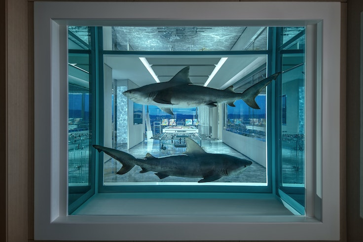 Two bull sharks frame the over-the-top game room in the new Damien Hirst–designed suite in the Vegas Palms.