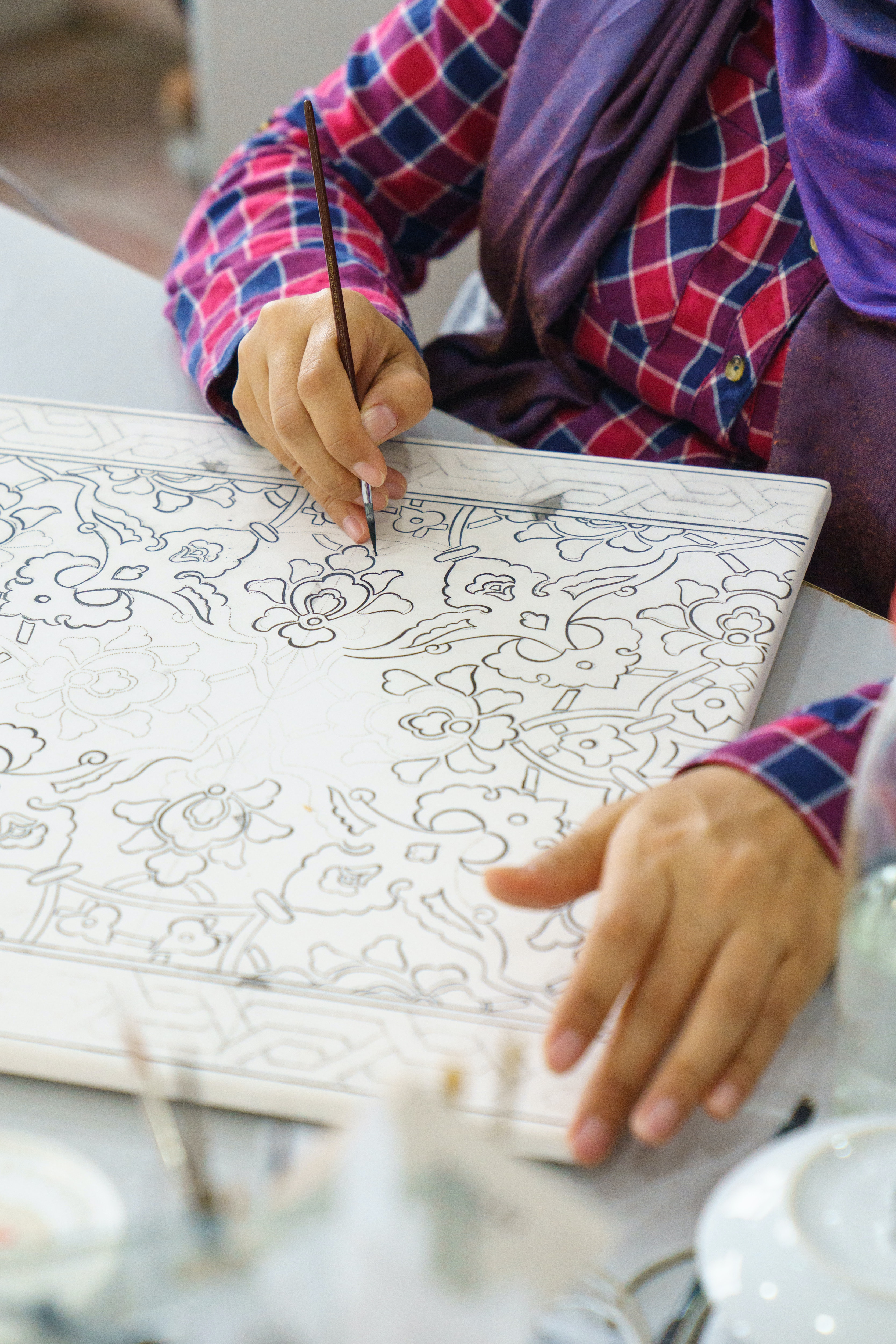 Designs are first drawn on sketching paper and perforated with a small needle.