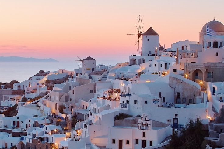 To see Santorini at sunset is an iconic Greek experience.