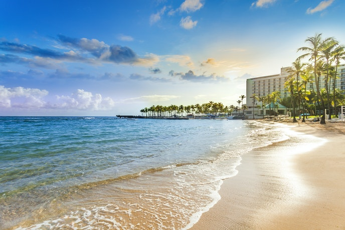 Book a points-backed stay at the iconic Caribe Hilton in Puerto Rico.