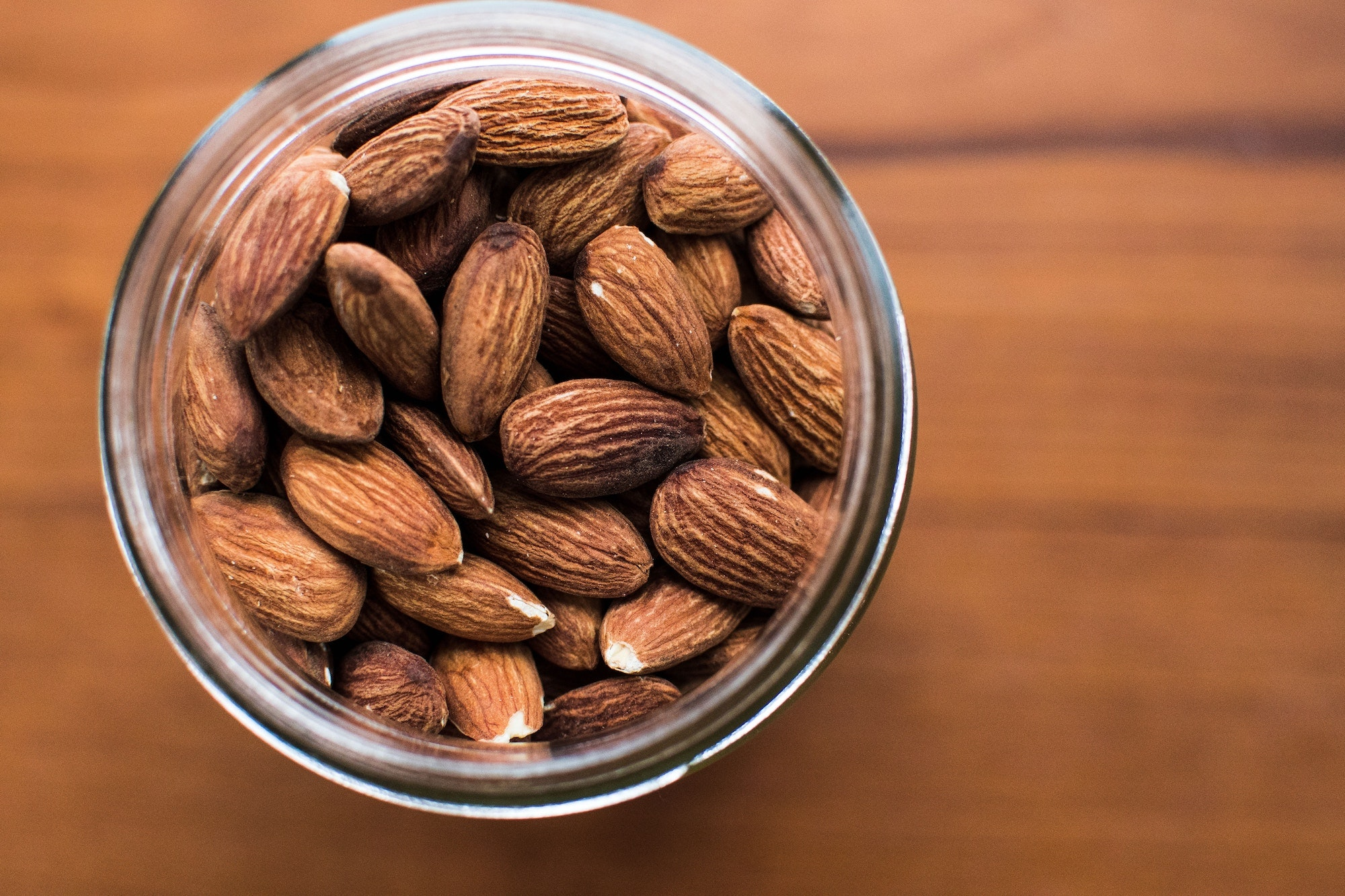 Eating almonds dry-roasted with a coating of tamari (a wheat-free type of soy sauce) can aid in lowering cholesterol.