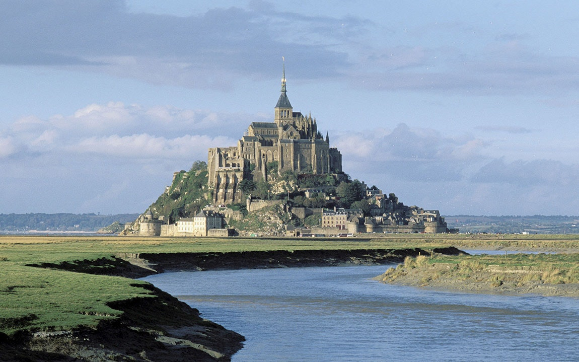 Mont St. Michel sits on a rocky outcrop off the coast of Normandy.
