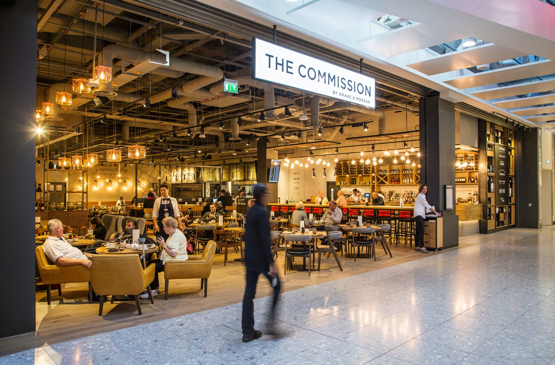 Once you pass security in Terminal 4, grab a seat at The Commission, where you can fuel up on hearty fare like burgers, fish and chips, and steaks.